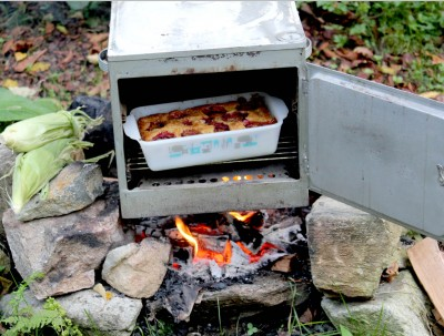portable oven over campfire