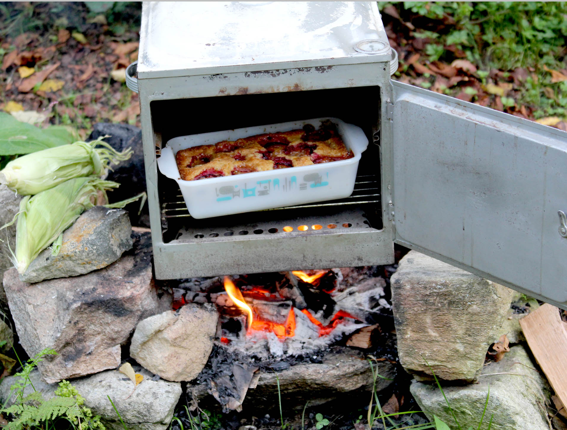 Portable oven over campfire log cabin cooking for How to cook in a dutch oven over a campfire