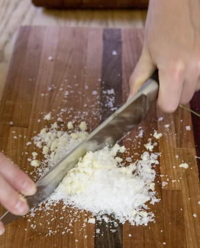 chop garlic and salt